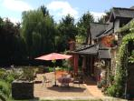 Sunny south facing terrace. Private and sheltered with stone barbecue.