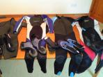 Selection of children's wetsuits for guests to use.