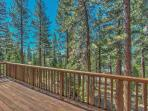 Deck overlooking the pine forest and Lake Tahoe.