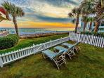 Relax in your backyard while taking in breathtaking views of the beach and water