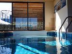 piscine chauffée à 30 ° et son jacuzzi