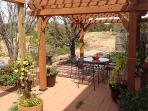 Beautiful back patio with grill and pergola, views of the greenbelt