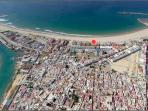 Areal view of the Barbate beach side. The apartment is marked with the red dot.