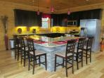 Large fully stocked kitchen with stacked stone center island that seats 6