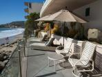Enjoy the Beach Sun from the Common Area Beachfront Deck