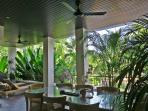 Large covered terrace with overhead ceiling fans