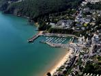 An aerial view of Saundersfoot with sandy beaches and pretty harbour.