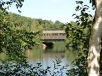 Covered bridge over cove on lake
