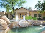 Vacation rental is located within a pristine gated community with beautiful fountains and landscape.
