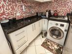 Kitchen with wash and dryer machine