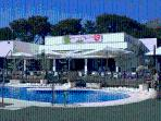The club house, with restaurant and pool area. Only 50 meters away from the apartment.