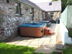 Enclosed garden with lawned area, patio, hot tub and BBQ in rural setting