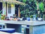 Outdoor dining in front of family bungalow