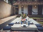 Outdoor dining and bungalow