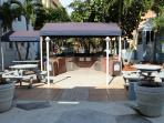 Two sides BBQ  with picnic tables and courtyard