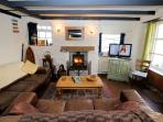Lovely open plan living area with real fire