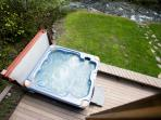 Jetted hot tub on the back patio looking out to Big Creek