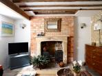Period features and antiques in the cosy sitting room