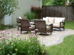 Comfortable outdoor furniture and grills for your use.