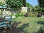 Lawn relaxing area and guests private access to car park