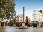 Famous Seven dials, surrounded by botique shops, cafes, theatres, and historic sites.