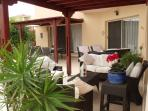 Spacious patio with dining area and comfortable al fresco lounge areas.