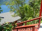 Wide cedar stairway from road to house, providing a lake view with every step.