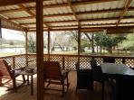 Covered front deck overlooks lake.It also features a 6 seat dining table.