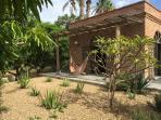 Hammock in front of master bedroom, and Aloe garden