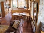 Spacious living area which is perfect for a family get together (extra dining chairs not shown).