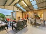 Main outdoor patio with couches, dining table & bbq - perfect space for gathering the group together