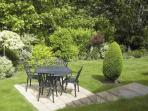 Large 'wrap round' beautifully maintained private garden with terrace areas front and side