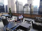 Rooftop Patio South - Guest enjoying a cigar and beer