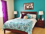 Master Bedroom with queen foam mattress and HDTV