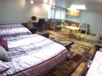 Queen's bedroom has two queen beds and two queen futons. Lots of room!