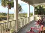 Outdoor speakers and 4 chairs await you and your ocean views from 2nd floor balcony