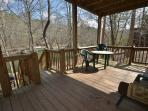 Beautiful deck that overlooks river.