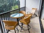 Bistro Table and Two Loungers on Lanai