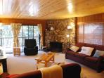 The living room includes a traditional stone fireplace (wood included)!