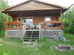 waterfront log cottage, just above the beach, private and scenic