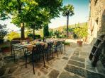 Pateo for family lunch under the refreshing shade of trees and the medieval building.