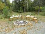 Fire pit is outside front of cabin