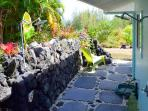 Many guests prefer the lovely new lava rock outdoor shower.
