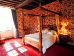 Master bedroom which showcases 17th century four-poster Louis VI style bed