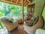 More seating under covered wrap around porch