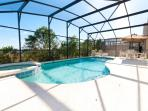 A large heated pool with lots of space around