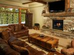 Family room with fireplace and 70 inch TV