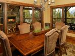 Dining room with view of the outdoor deck & fireplace