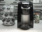 Keurig Coffee machine with 8 complimentary coffee cup supply (to hold you over a couple of days)