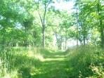 The groomed trail takes guests along the river and into the hills and woods.
